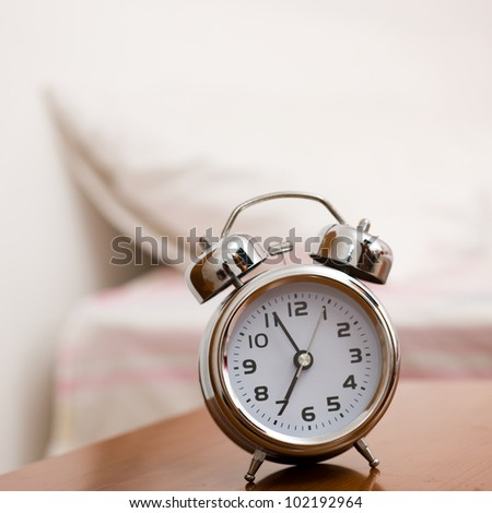 Alarm clock on night table at bed