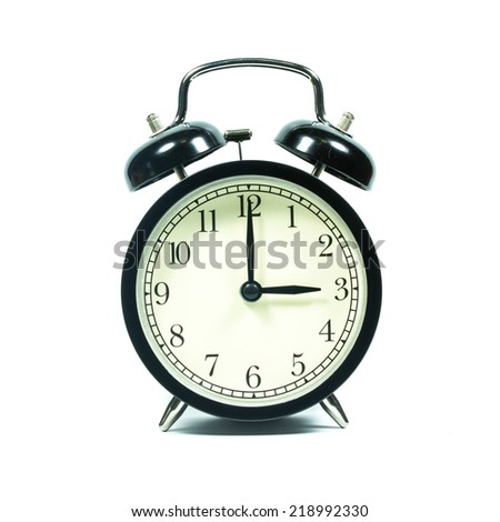 Alarm clock on white background. At 3 .