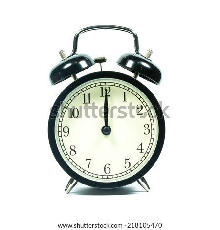 Alarm clock on white background. At noon. At midnight.