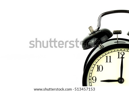 Alarm Clock on white, showing nine o'clock.