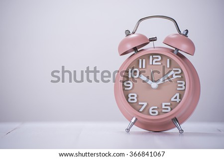 alarm clock on wooden table with copy space