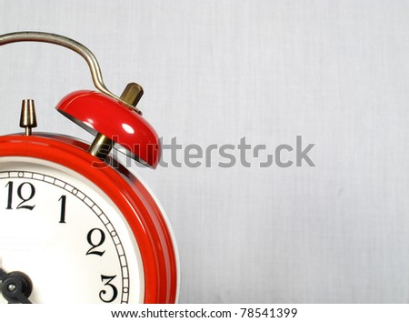 Alarm clock red in the foreground - stock photo
