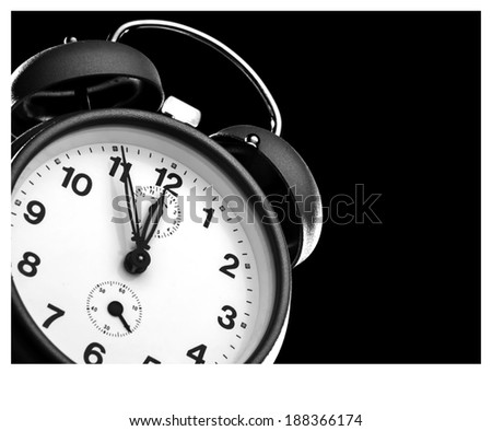 Alarm clock shows five to twelve