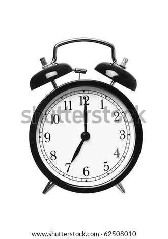Alarm clock shows seven o`clock isolated on white background