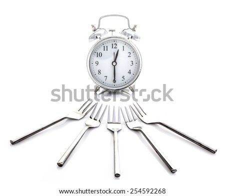 Alarm Clock - Time for Lunch With Forks on a White Background - stock photo