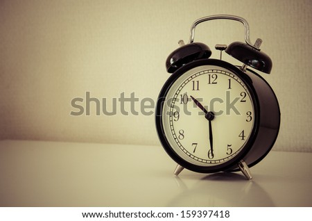 alarm clock watch on vintage background