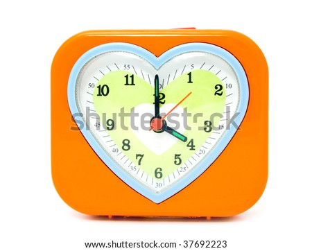 alarm clock with a heart on a white background - stock photo