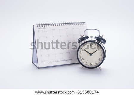 alarm clock with calendar. alarm clock with calendar on background