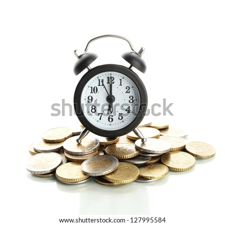 Alarm clock with coins isolated on white