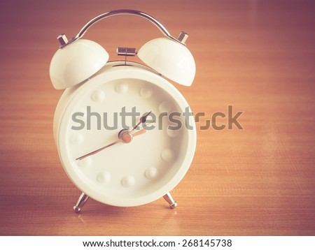 alarm clock with filter effect retro vintage style - stock photo