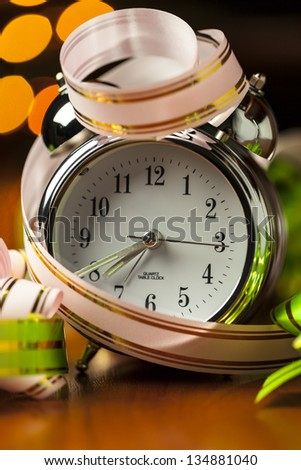 Alarm Clock with green and pink ribbons (close up) - stock photo