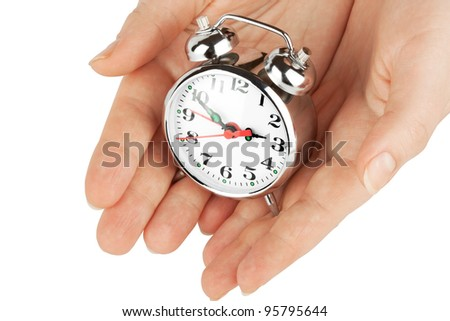 Alarm clock with hands on white background showing save the time concept