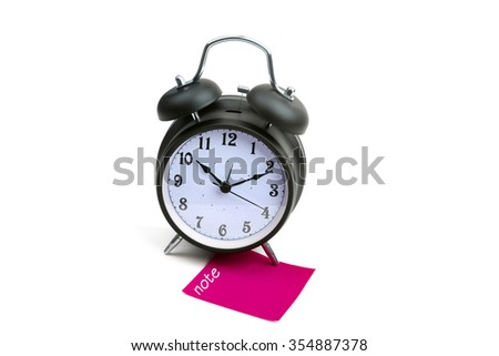 Alarm clock with note pink sticky paper - stock photo