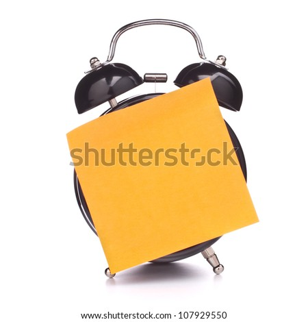 Alarm clock with sticky paper isolated on white background - stock photo