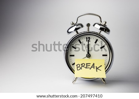 Alarm clock with sticky paper note BREAK time on white background - stock photo