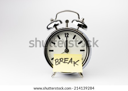 Alarm clock with sticky paper note on white background - stock photo