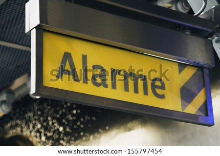 Alarm sign at a railroad station, Paris, France