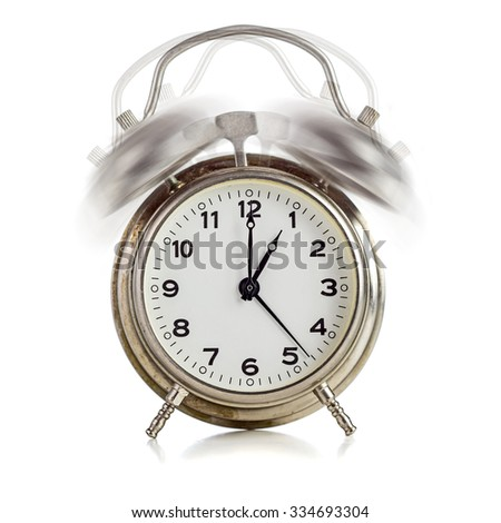 Alarming old dirty vintage metal clock showing one o'clock over white background - stock photo