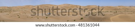 ALASHAN, CHINA-JULY 22, 2016: Sports car gets over the difficult part of the route during the  Silk Way rally Moscow-Beijing Dakar series in the  sand desert