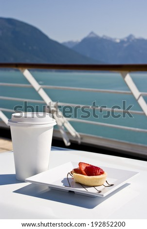 Alaska - Enjoy Haines - Delight With A Strawberry Mini Tart And Hot Drink On The Deck Of Cruise Ship - Travel Destination / Alaska - Delight With A Strawberry Mini Tart And Hot Drink On The Deck