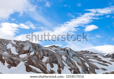 Alaska glacier with brilliant blue sky and clouds at Glacier Bay National Park