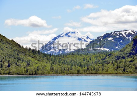 Alaska landscape lake, mountains and forest - stock photo