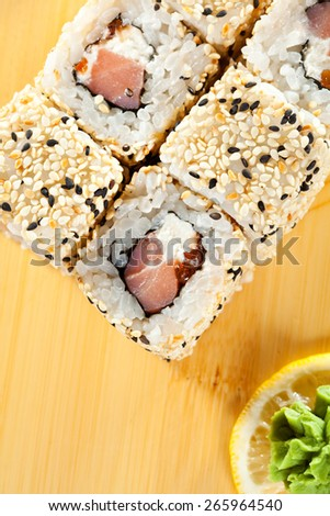 Alaska Maki Sushi - Roll with Smoked Salmon, Cream Cheese and Salmon Roe inside. Sesame outside - stock photo