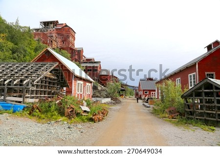 ALASKA, USA - AUGUST 08 - Kennecott Mill Town in Alaska on August 08. 2014. The 14-storey Kennicott Concentration Mill ,and the mines became a tourist destination. - stock photo