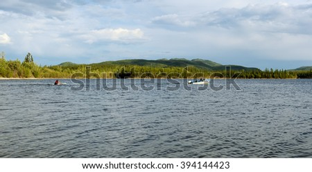 ALASKA, USA-JULY 4, 2009: waterskiing on a lake in the wilderness