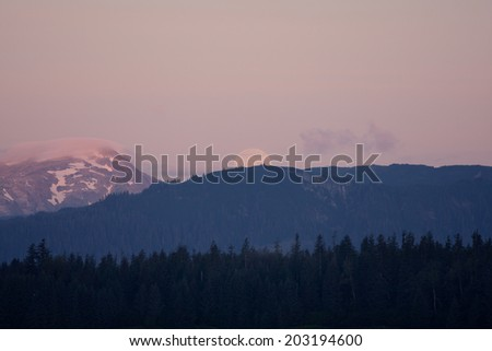 Alaskan Moon-set Moon sets behind mountains as sun rises in opposite direction