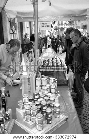 ALBA, ITALY/CUNEO - OCTOBER 24: a stall of truffle sellers in Alba, little city in the Province of Cuneo (Piedmont, Northern Italy), during the international truffle fair. Alba, October 24, 2015 - stock photo