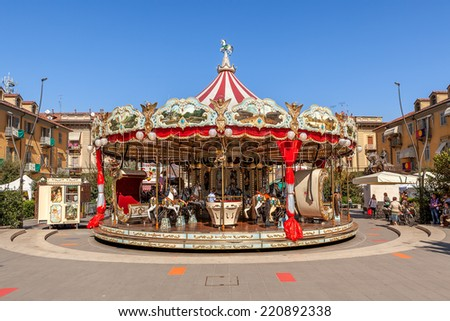 ALBA, ITALY - OCTOBER 02, 2011: Carousel on city square as part of famous annual White Truffle festival and celebrations taking place each year in october in Alba, Italy. - stock photo
