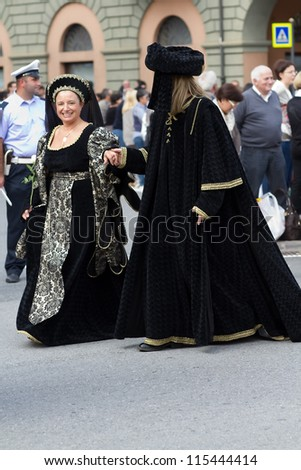 ALBA, ITALY-OCTOBER 7: Unidentified participants dressed in medieval clothes parade at the historical city during International Exhibition of truffles of Alba on October, 7.2012 in Alba, Italy. - stock photo