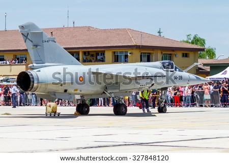ALBACETE, SPAIN-JUN 23: Aircraft Dassault Mirage F1 taking part in an exhibition on the open day of the airbase of Los Llanos on Jun 23, 2013, in Albacete, Spain - stock photo