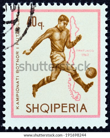"ALBANIA - CIRCA 1966: A stamp printed in Albania from the ""Football World Cup - England "" issue shows soccer player and map of Chile (1962), circa 1966.  - stock photo"