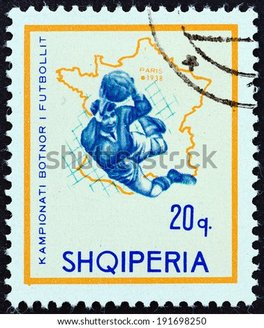 "ALBANIA - CIRCA 1966: A stamp printed in Albania from the ""Football World Cup - England "" issue shows soccer player and map of France (1938), circa 1966.  - stock photo"