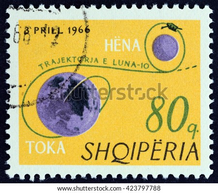 """ALBANIA - CIRCA 1966: A stamp printed in Albania from the """"Luna 10 """" issue shows Earth, Moon and trajectory of Luna 10, circa 1966. - stock photo"""