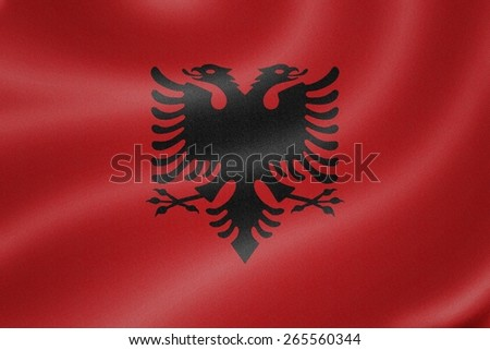 Albania flag on the fabric texture background