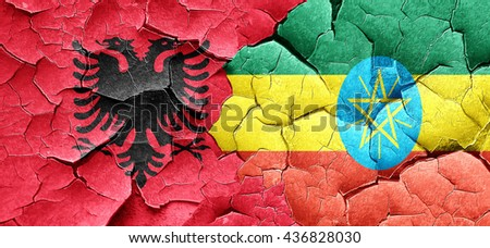 Albania flag with Ethiopia flag on a grunge cracked wall - stock photo