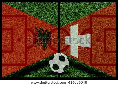 Albania vs Switzerland football flag background on green pitch - stock photo