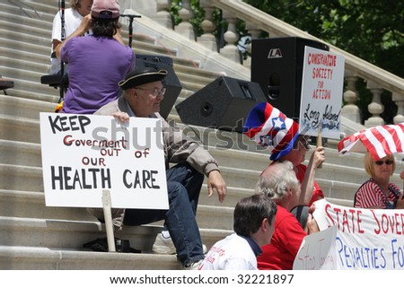 "ALBANY, NY - JUNE 16: Protesters against wasteful government spending and corrupt career politicians sits during the Tea Party Patriots ""March on Albany"" protest on June 16, 2009 in Albany NY"