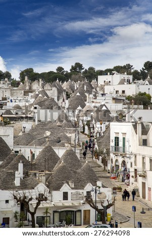 ALBEROBELLO, ITALY- APRIL 4, 2015: Streets in Albertobello, Italy. The Trulli of Alberobello have been designated as a UNESCO World Heritage site since 1996.