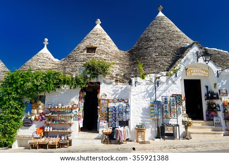 ALBEROBELLO, ITALY - MAY 30, 2015: Traditional trulli houses in Alberobello - stock photo