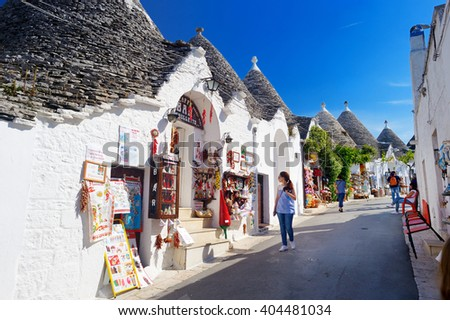 ALBEROBELLO, ITALY - MAY 30, 2015: Traditional trulli houses in Alberobello, Italy - stock photo