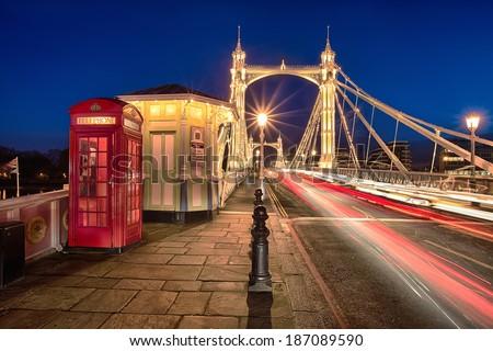 Albert bridge illuminated by lights at night with traffic  - stock photo