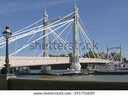 Albert Bridge over the River Thames in London, England - stock photo