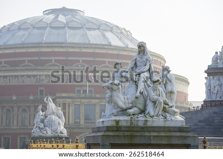 Albert Memorial statue overlooking hazy Royal Albert Hall, in London. The concert hall is home to the Proms, which take place each summer since 1941. - stock photo