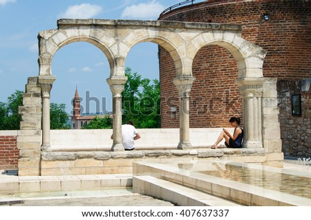 ALBI, FRANCE - JULY 12, 2013: A quiet plaza with people relaxing in southern France