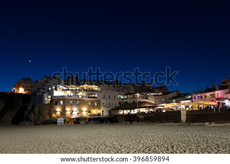 Albufeira, Algarve, Portugal May 1 ,2014: Albufeira beach at night, Algarve, Portugal - stock photo