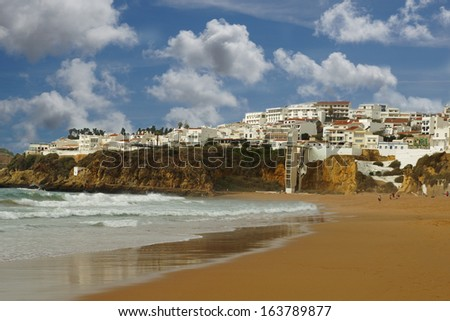 Albufeira old town and beach with blue sky and white clouds